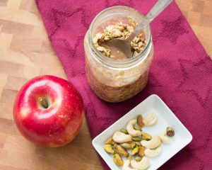 Sue's Overnight Oats with nuts and an apple