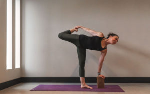 Women Doing yoga with yoga block - Kind Living - Orillia