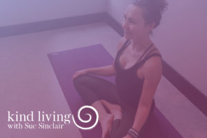 Video Title Image - Woman Sitting Cross Legged on Yoga Mat - Purple Overlay - Kind Living with Sue Sinclair