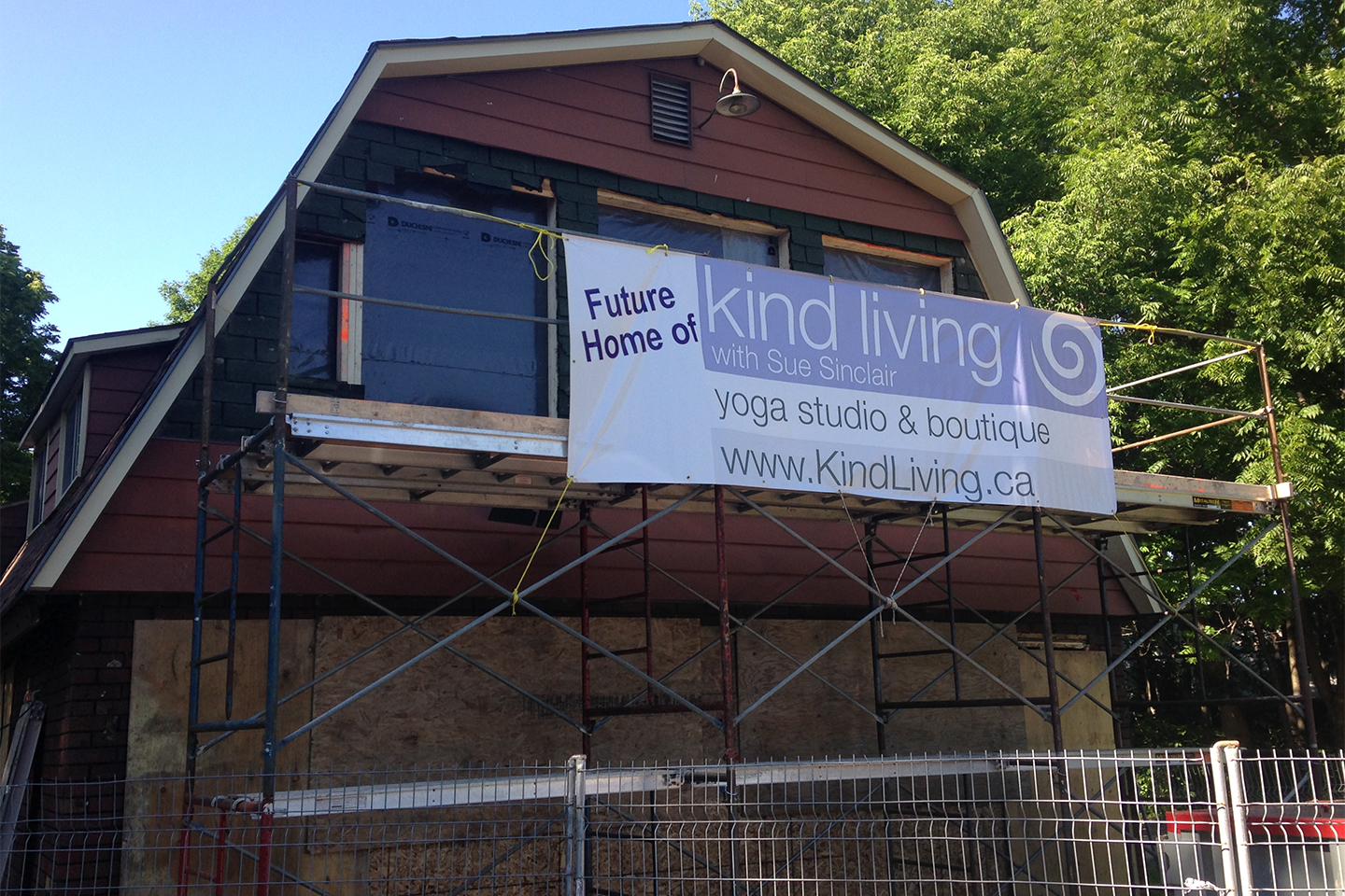Kind Living With Sue Sinclair - Yoga Studio and Boutique Sign