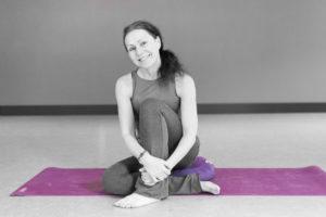 Sue Sinclair on Purple yoga mat